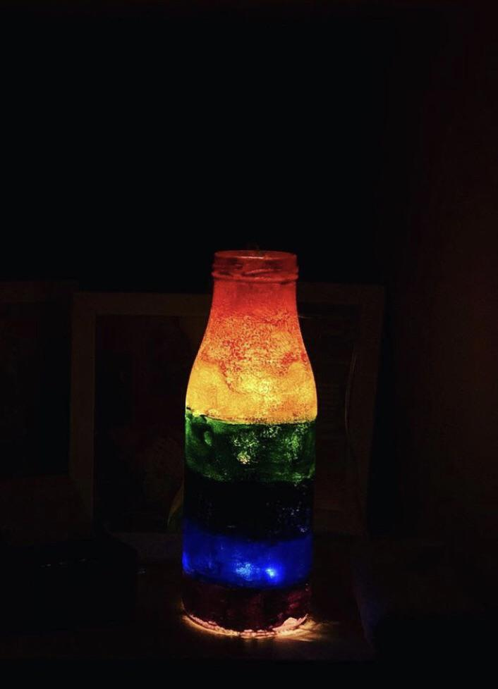 decoration of a bottle with colours and lights